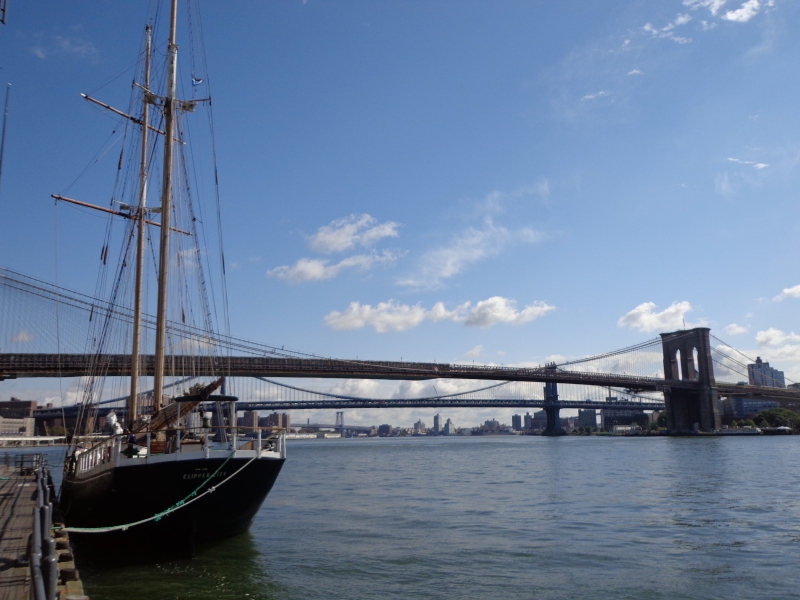 image of sailboat on East River, NYC