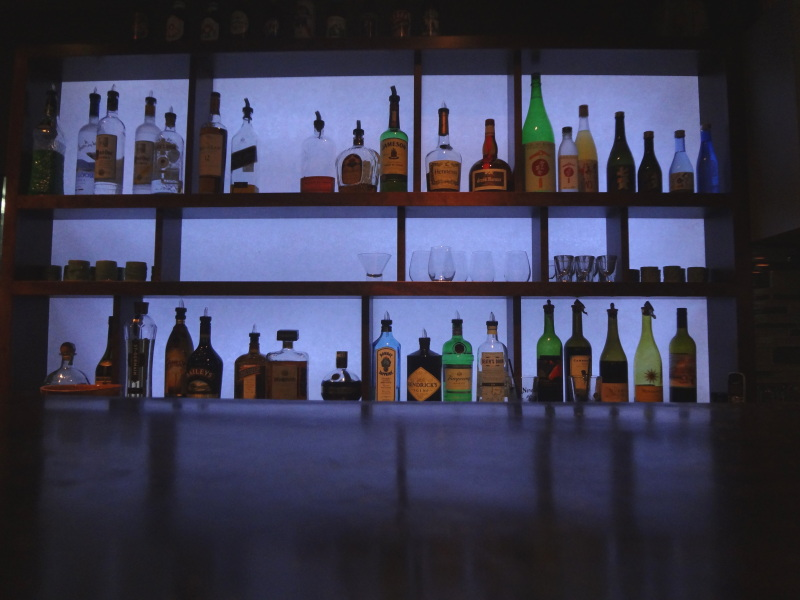 image of bottles behind the bar at Umami